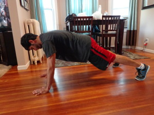 Jump your feet back so your body is in a pushup position (optional add pushup here)